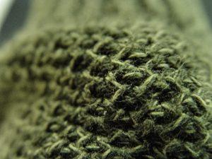 Foto: Grüner Wollpullover (Ausschnitt)