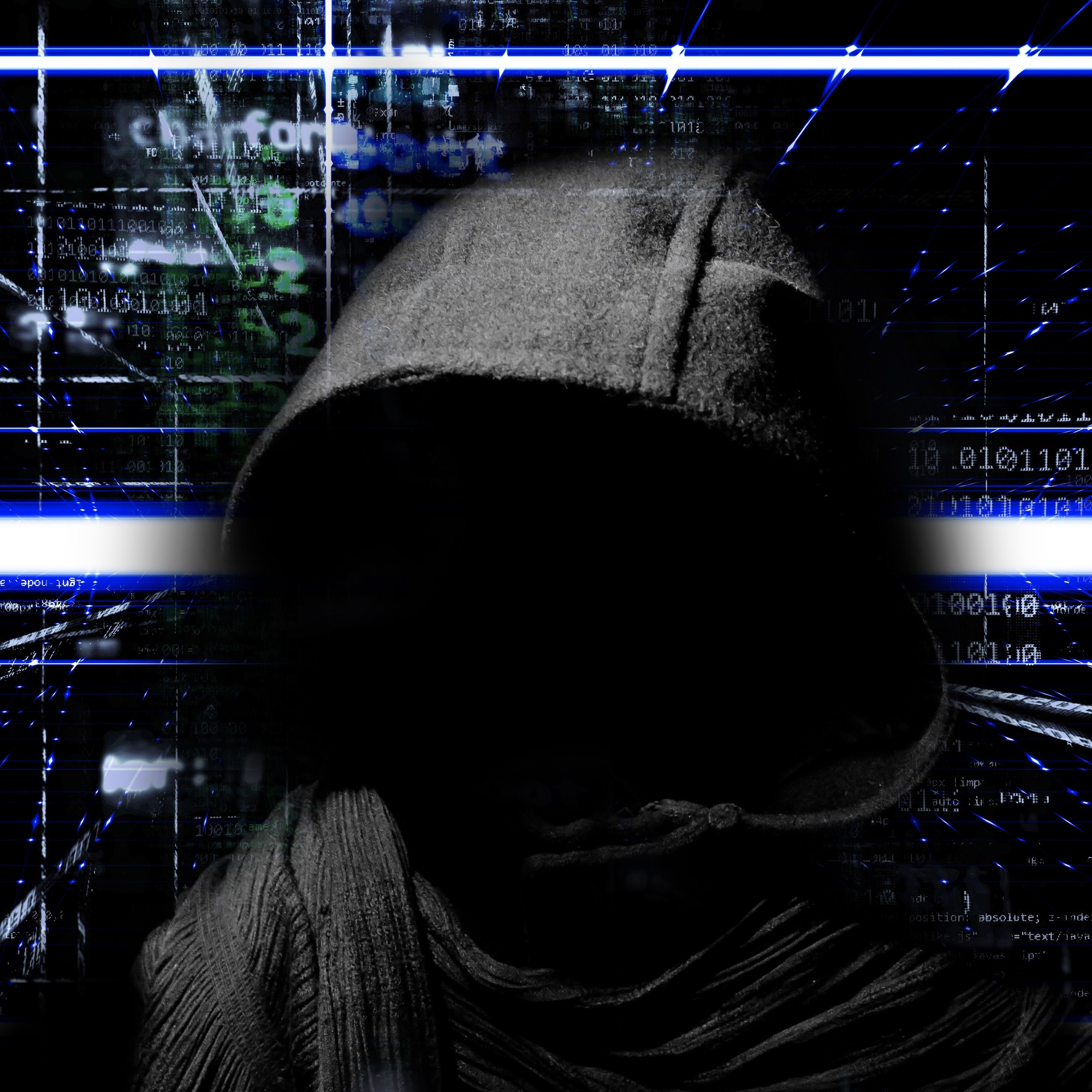 Bild: Medientypisches Klischeebild von einem Hacker mit Hoodie in schwarzer Umgebung